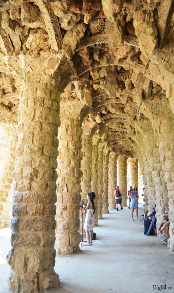 Artist in colonnaded footpath, Park Guell - Spain